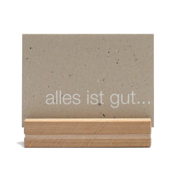 Schlichte Bildleiste 14cm aus Eichenholz und Gummiband zum Klemmen von Postkarten, Fotos oder Notizen - von Raumgestalt.