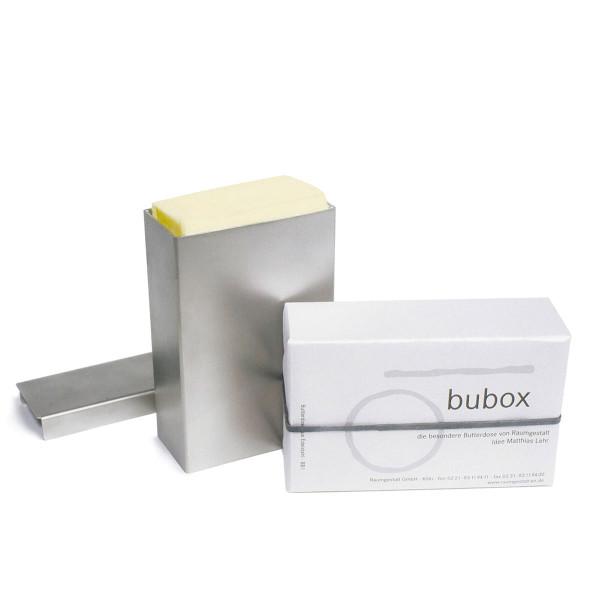 Butterdose Bubox aus rostfreiem Edelstahl mit integrierter Schiebevorrichtung - einmal mit Butter bestückt und einmal verpackt.