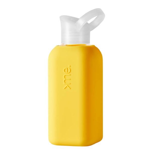 Squireme. Design Trinkflasche aus Glas mit Silikon-Bezug in neon gelb