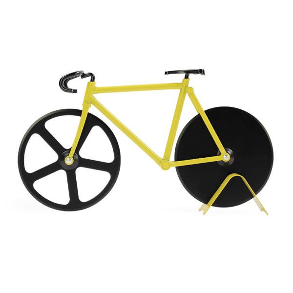 Ein gelbes Rennrad zum Pizza schneiden. Das ist der originelle Pizzaschneider THE FIXIE bumblebee von doiy design. Fahrrad Pizzaschneider.