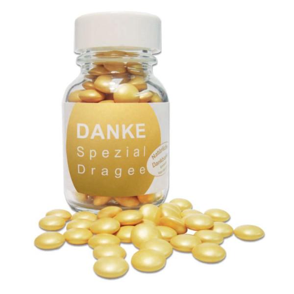 liebeskummerpillen Danke Spezial Dragées - goldene Mini Schoko Linsen in kleiner Glasflasche.