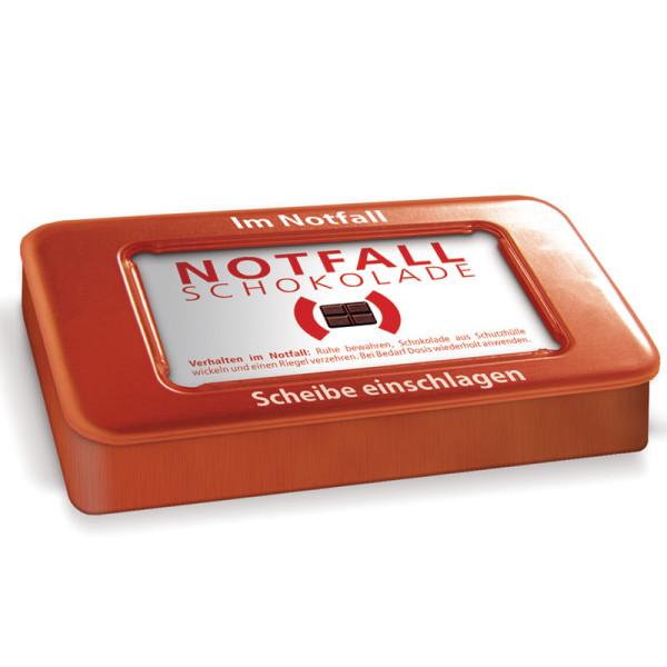 Notfallschokolade von liebeskummerpillen: kleine Edelvollmilchschokolade in roter Geschenk-Blechdose.