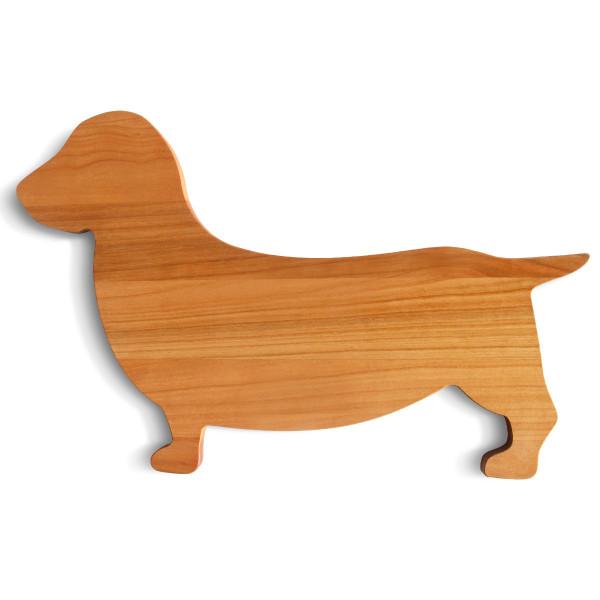 Servierbrett in Form eines Dackels aus massivem Nussbaumholz von side by side.