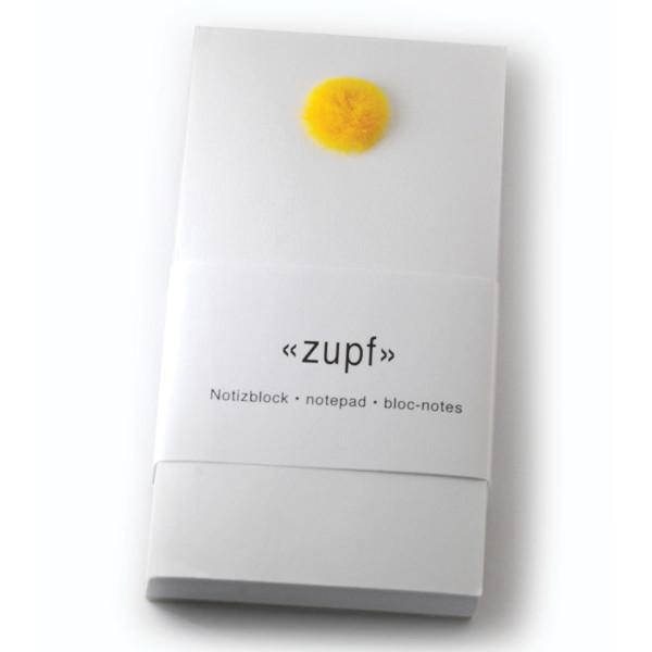 Notizblock zupf mit gelben Pompon