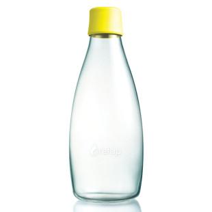 Retap Trinkflasche 0,8l aus Borosilikatglas mit gelbem Deckel.