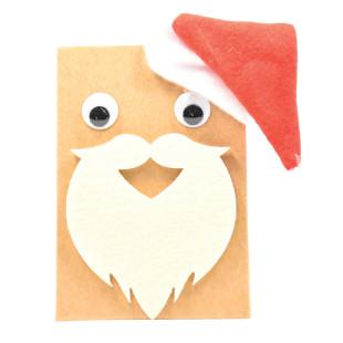 Heiße Schokolade: Perfekt für kalte, frostige Wintertage: die Weihnachtsmann Tüte mit Trinkschokolade. Weihnachtsmann Geschenktüte mit Schokoladen DIY Set von Wunderle.