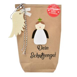 Glücksbringer Geschenktüte von Wunderle. Braune Papiertüte, befüllt mit netten Kleinigkeiten