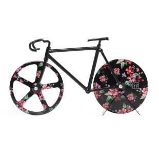 Ein Rennrad zum Pizza schneiden. Pizzaschneider THE FIXIE wildrose von doiy design. Fahrrad Pizzaschneider mit blumigen Print.