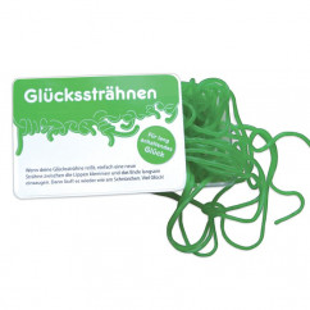 liebeskummerpillen Glückssträhnen: grüne Fruchtgummischnüre mit Apfelgeschmack in kleiner Kunststoffbox.