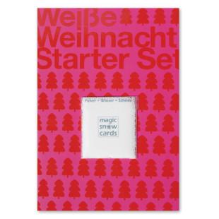 liebeskummerpillen Postkarte Weiße Weihnacht Starter Set: rote Postkarte mit Magic Snow Schneepulver.