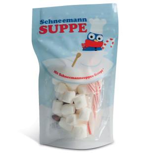 Schneemann Suppe von liebeskummerpillen: Kleine weisse Marshmallows, eine Zuckerstange und braune Mini-Schokolinsen in netter Kunststoff-Verpackung.