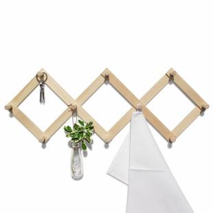 Wandgarderobe Lia von side by side design. Nicht nur optisch ein Highlight. 10 Wandhaken und die variable Breiteneinstellung machen Sie zum praktischer Helfer im Haushalt.