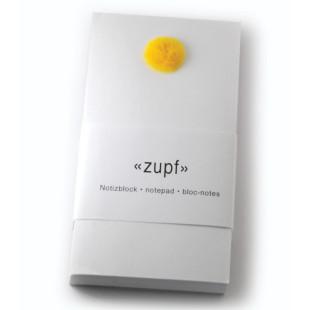 Notizblock zupf mit gelben Pompon. Hochwertiger Block mit Deko-Pompon vom schweizer Designlabel tät tat.